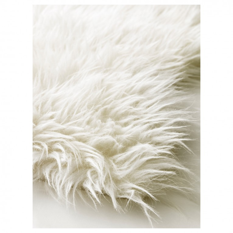 Alluring White Fur Rug With Best Wooden Laminate Flooring And Sofa Chairs For Living Room Ideas