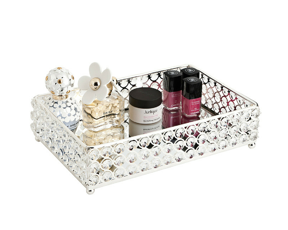 Amazing mirror tray with parts of cosmetics