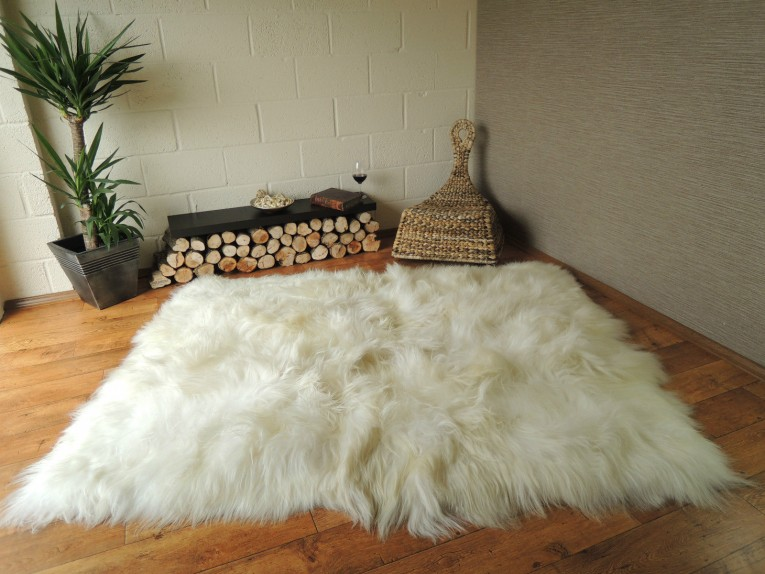 Breathtaking White Fur Rug With Best Wooden Laminate Flooring And Sofa Chairs For Living Room Ideas