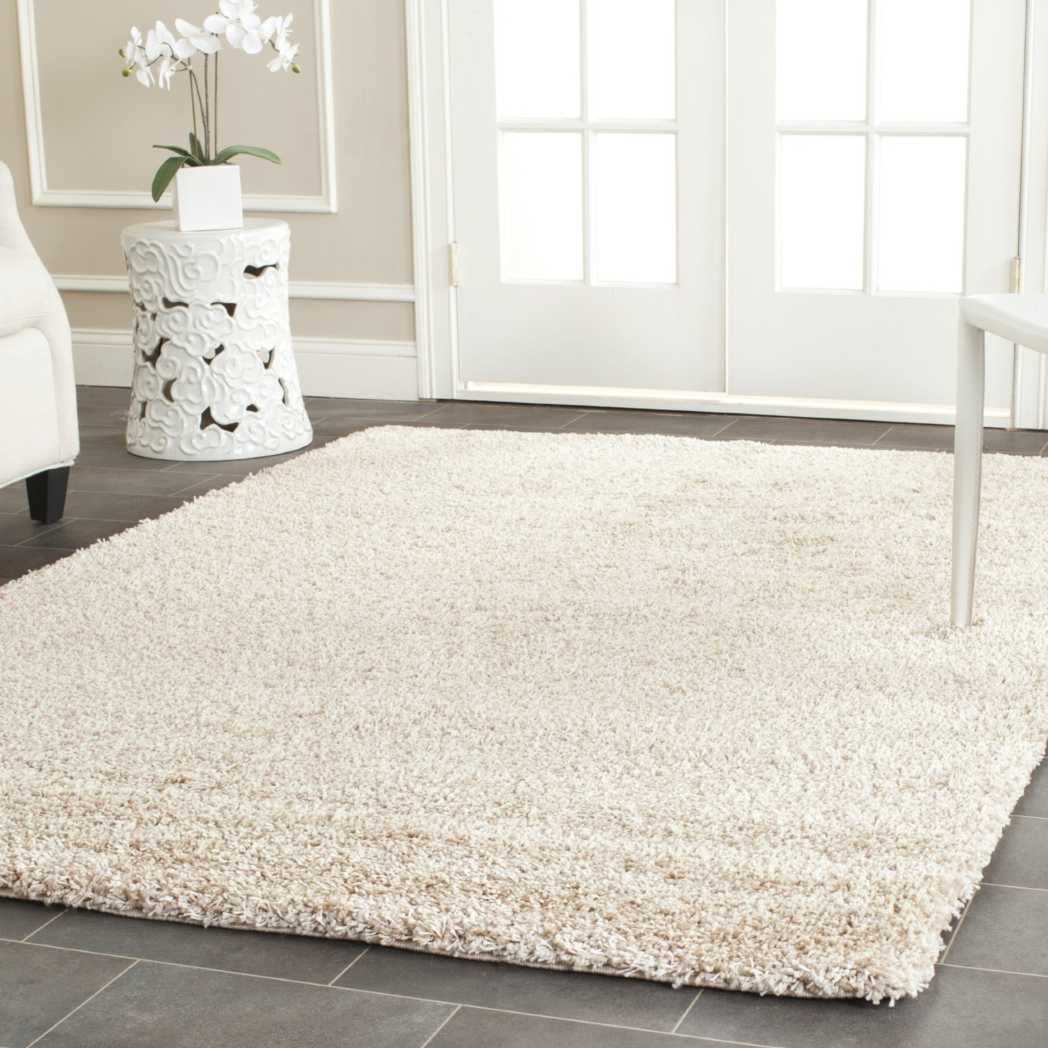 Chic white fur rug with Best wooden laminate flooring and sofa chairs for living room Ideas