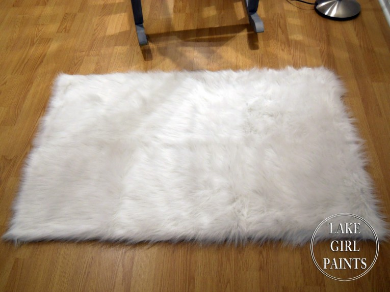 Classy White Fur Rug With Best Wooden Laminate Flooring And Sofa Chairs For Living Room Ideas
