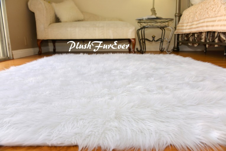 Cozy White Fur Rug With Best Wooden Laminate Flooring And Sofa Chairs For Living Room Ideas