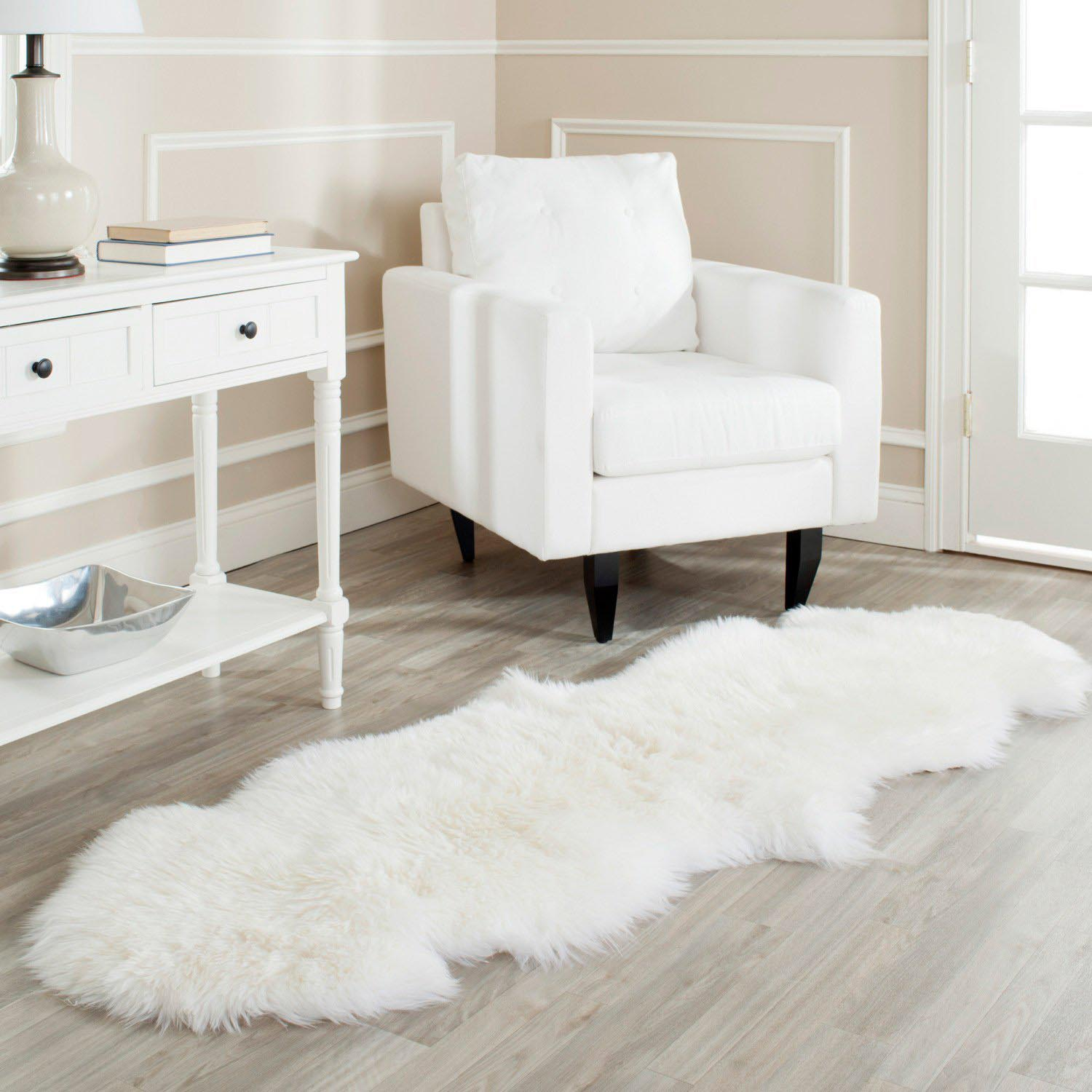 Creative white fur rug with Best wooden laminate flooring and sofa chairs for living room Ideas