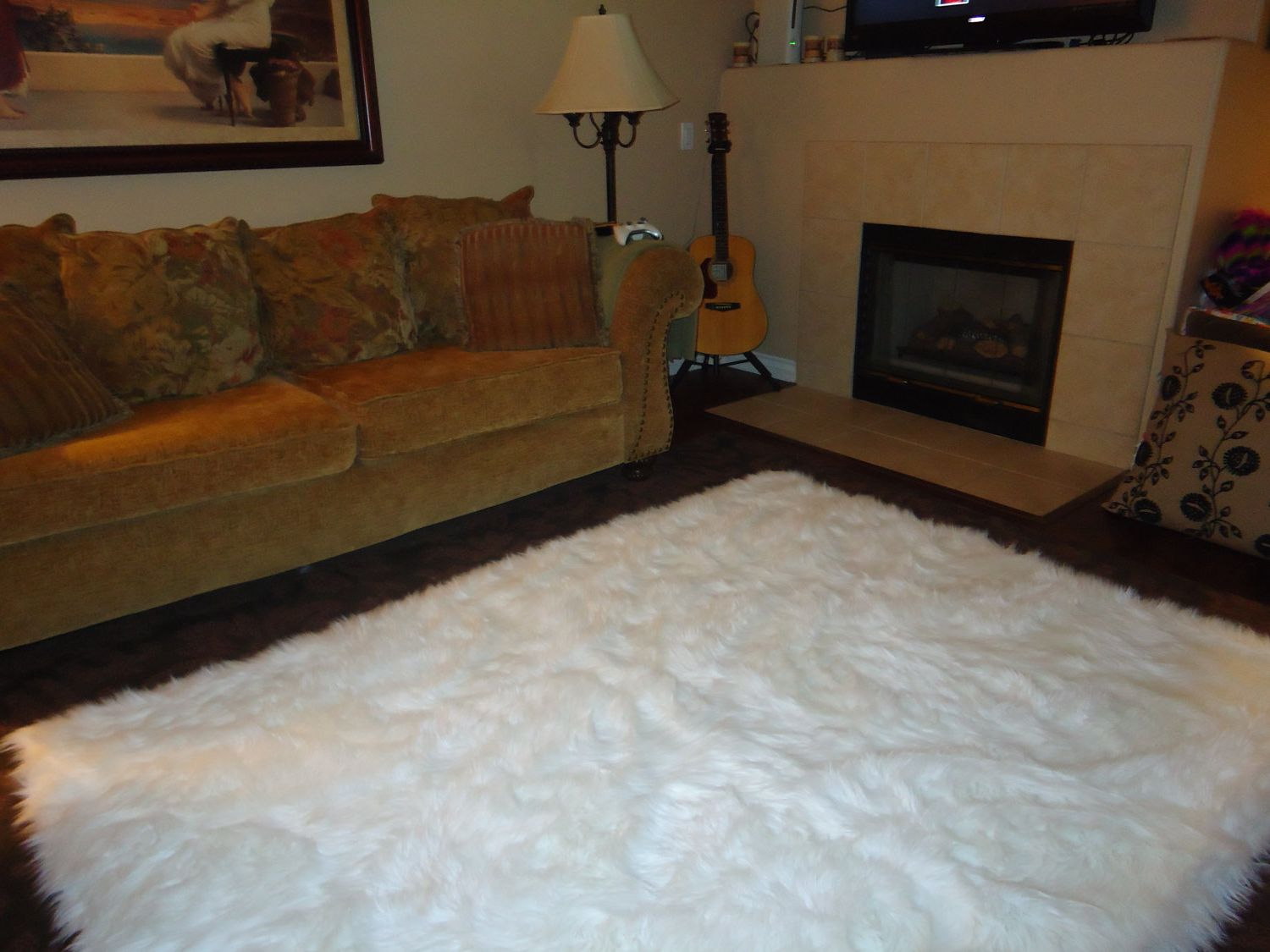 Dazzling white fur rug with Best wooden laminate flooring and sofa chairs for living room Ideas