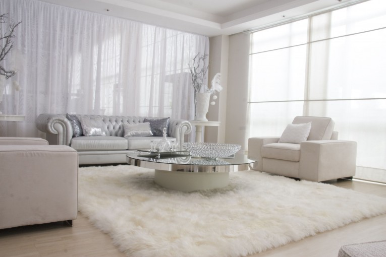 Elegant White Fur Rug With Best Wooden Laminate Flooring And Sofa Chairs For Living Room Ideas