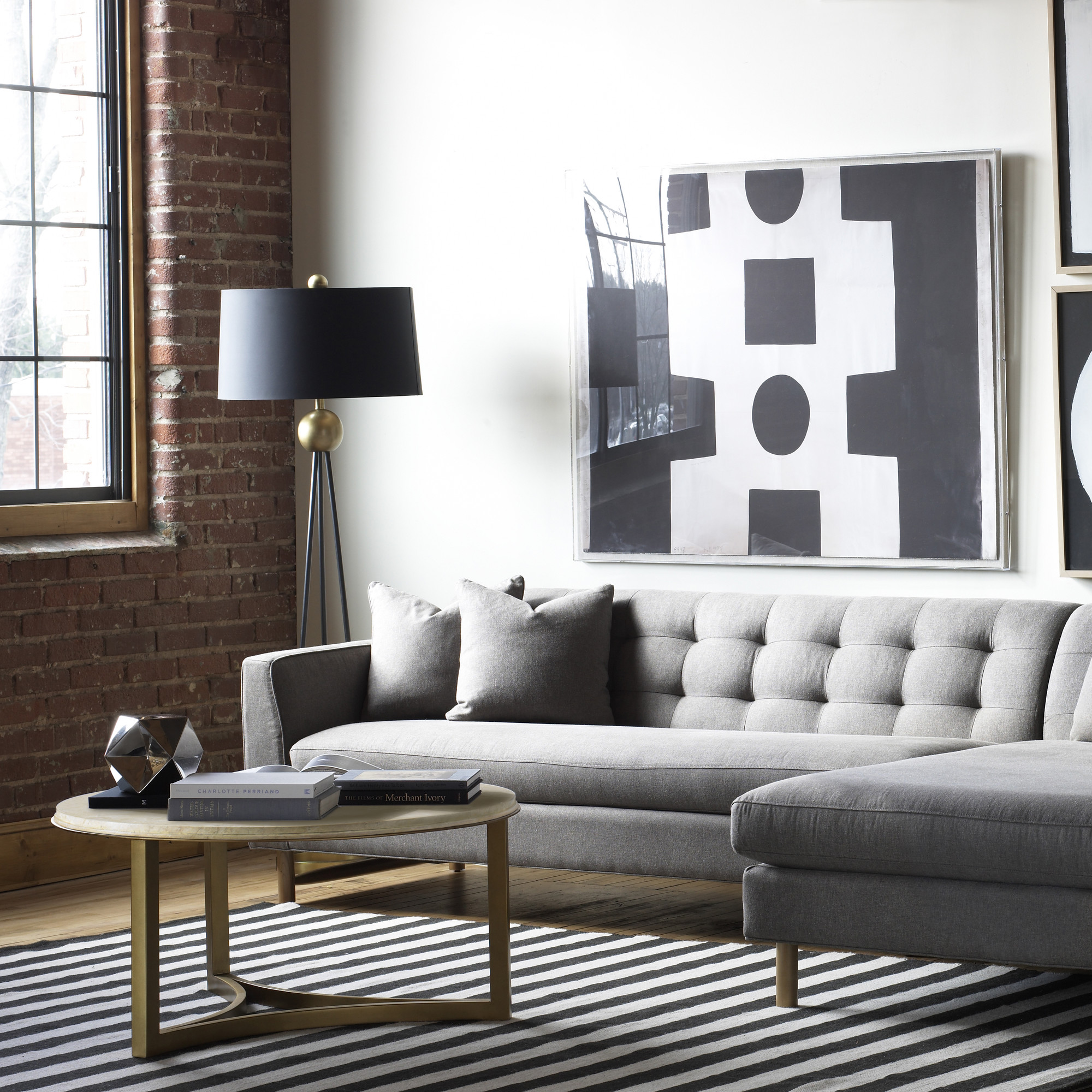 amazing dwellstudio with black stand lamps and gray sofa plus round table