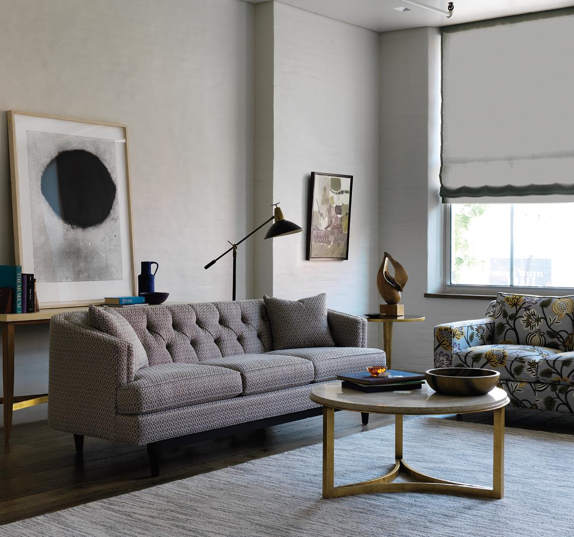 dwellstudio with round coffee table and area rugs