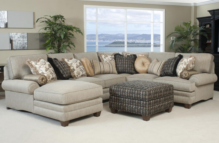 Gray Sectionals Sofas With Palm Tree At Living Room
