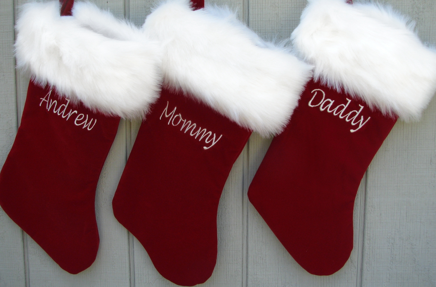 three family reds monogrammed stockings in the christmas display for living room ideas