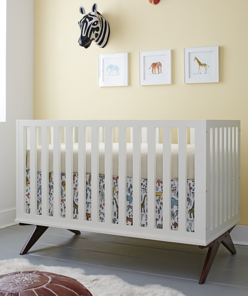 unique baby cribs dwellstudio with white cow hide rugs