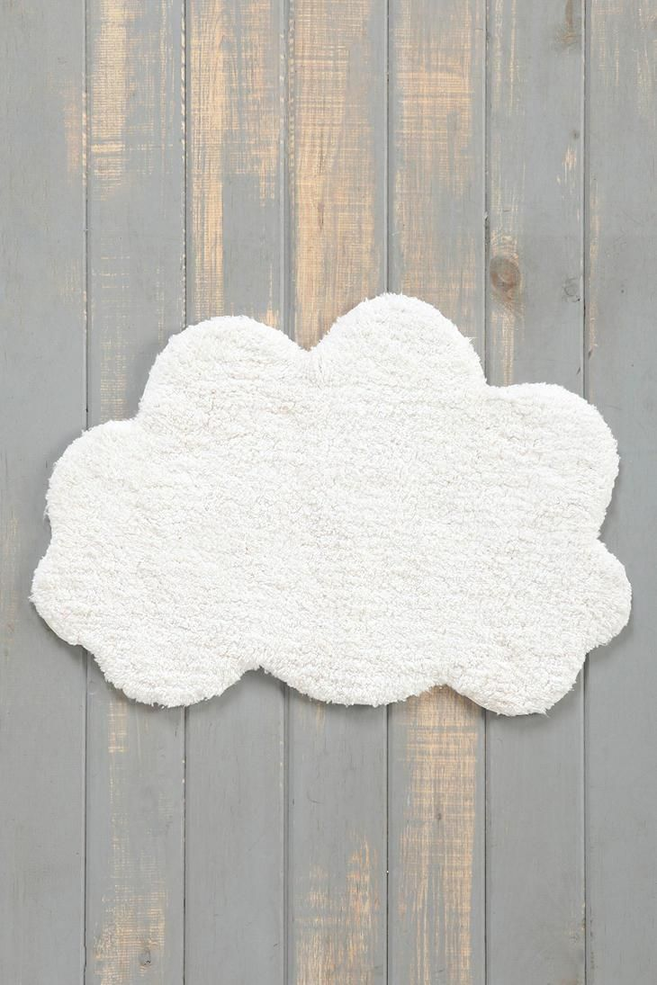 white sky bath mat with wooden floor
