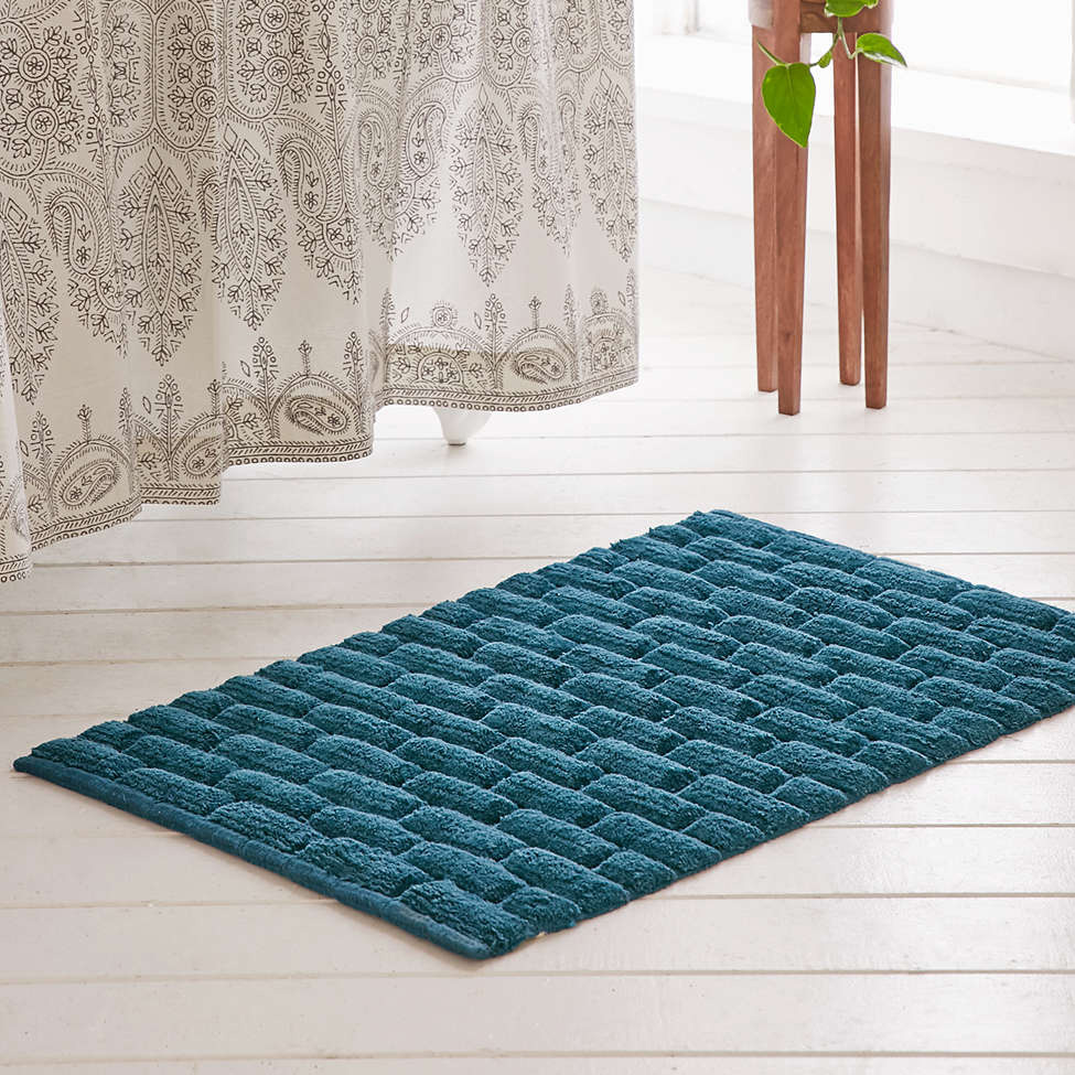 wondrous blue bath mat and wooden floor
