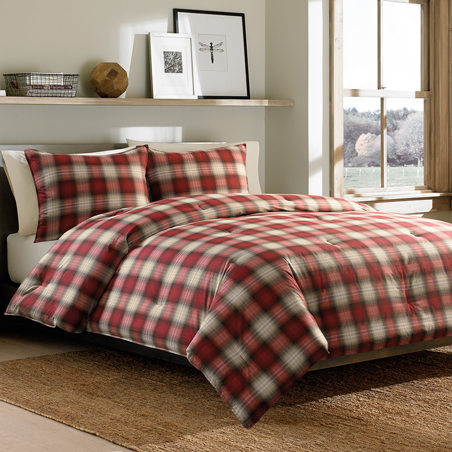 Admirable plaid comforter with rugs and wooden floor plus headboard and sidetable also pillows