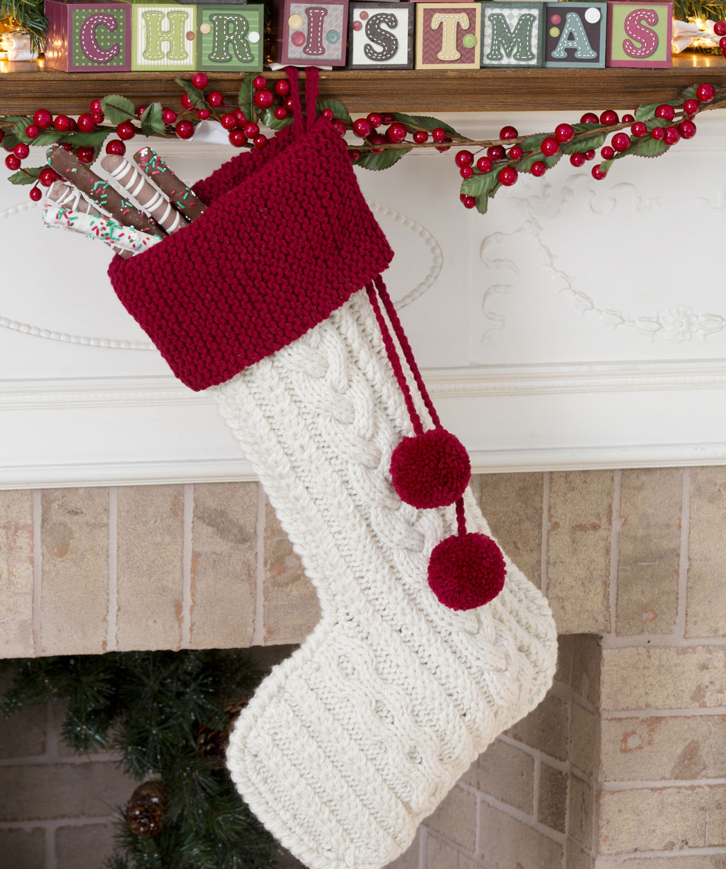 Adorable knit christmas stockings with multicolorful christmas stocking and fireplace at chistmas day interior design