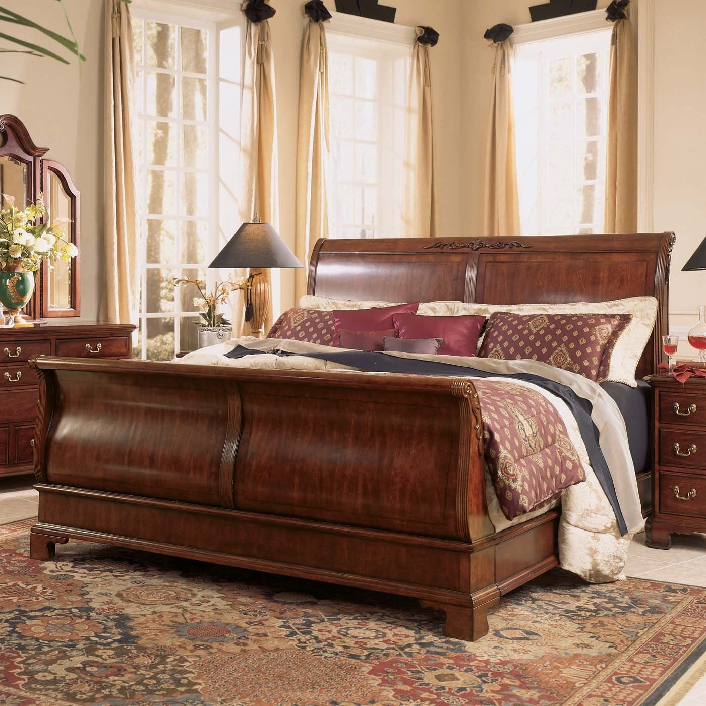 Alluring headboars king sleigh bed with royal duvet cover and luxury sheets also unique area rug above laminate flooring ideas