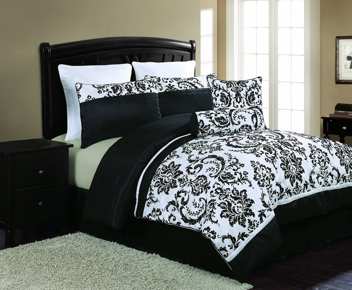 Amazing Bedroom with black and white comforter sets and laminate porcelain floor also curtain and sidetables