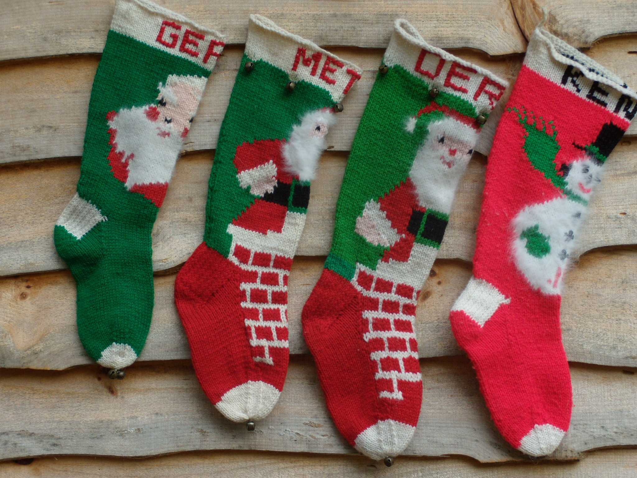 Amazing knit christmas stockings with multicolorful christmas stocking and fireplace at chistmas day interior design