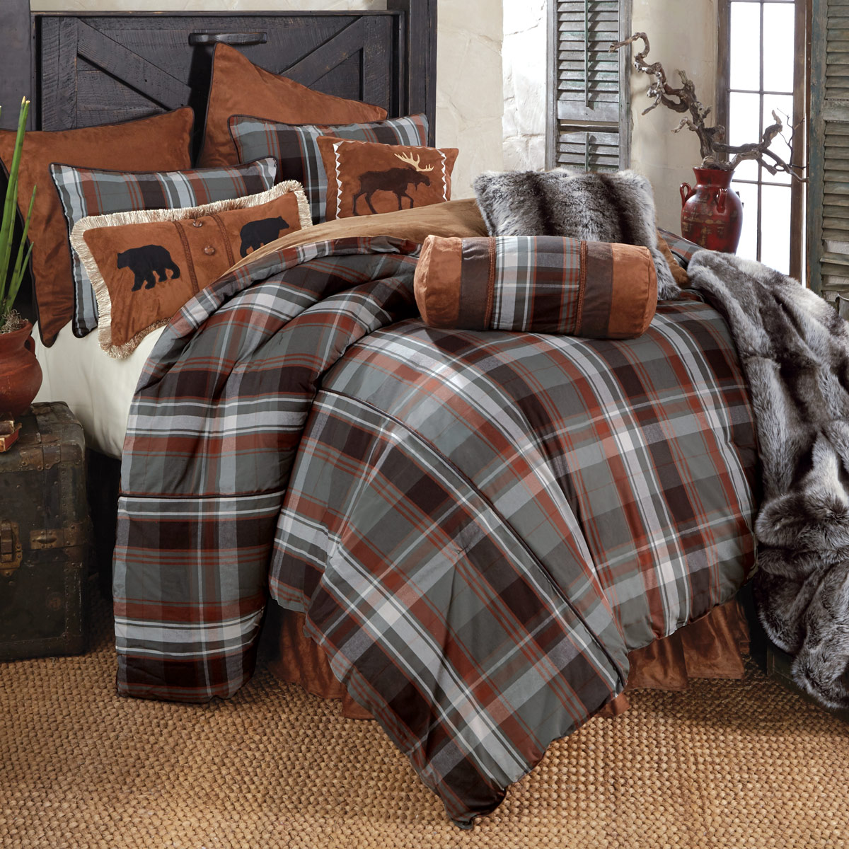Appealing plaid comforter with rugs and wooden floor plus headboard and sidetable also pillows