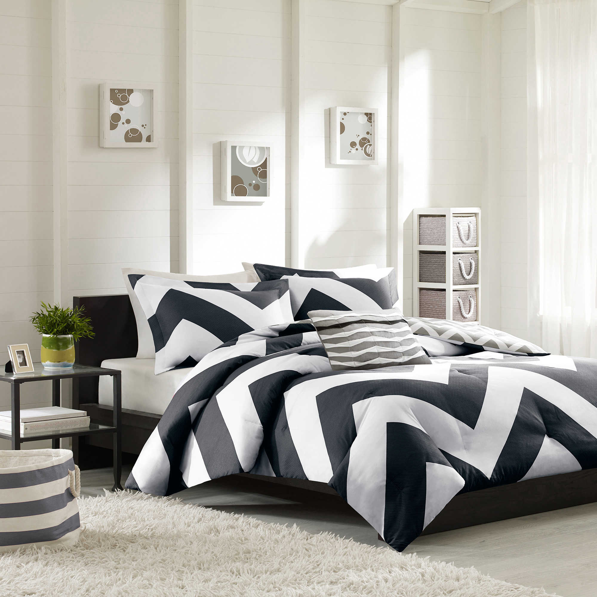 Astonishing Bedroom with black and white comforter sets and laminate porcelain floor also curtain and sidetables