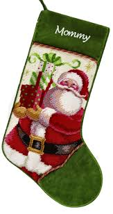 Astounding needlepoint stockings and fireplace with mantle shelves in the christmas day
