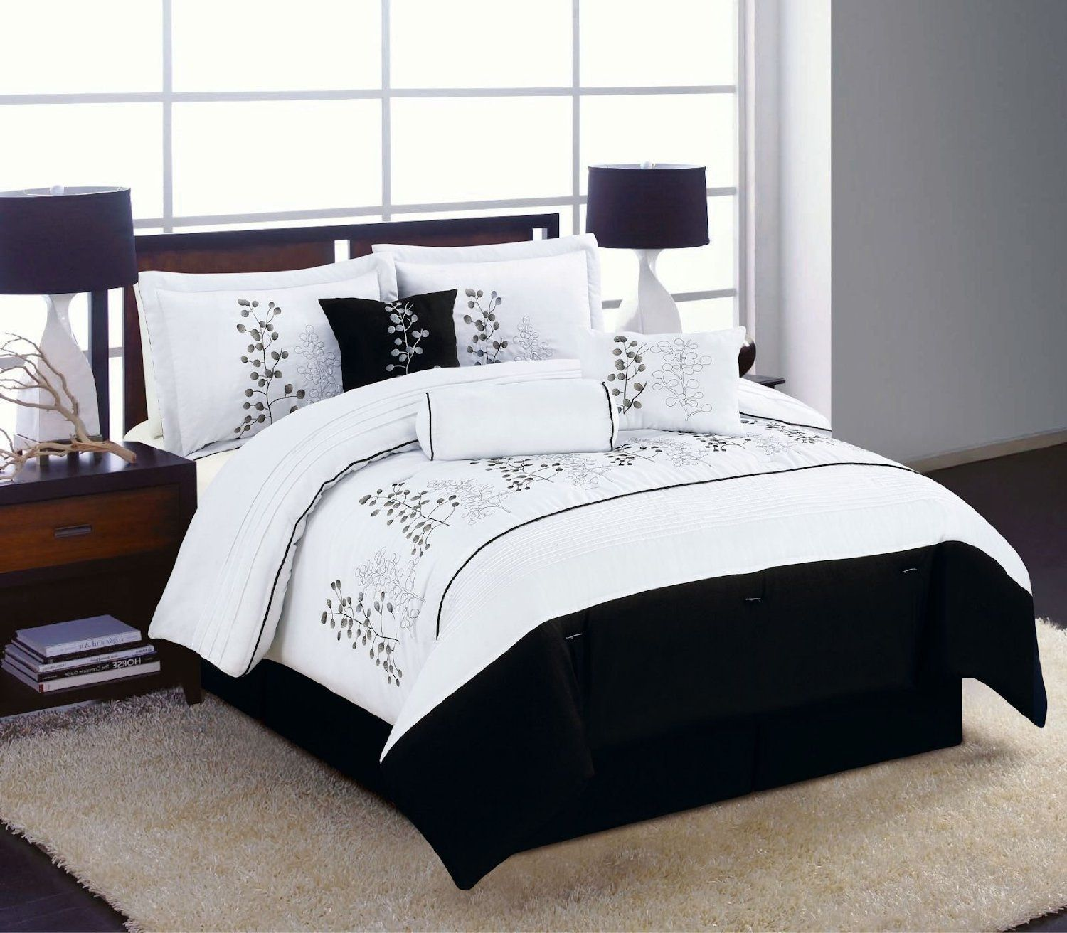Awesome Bedroom with black and white comforter sets and laminate porcelain floor also curtain and sidetables