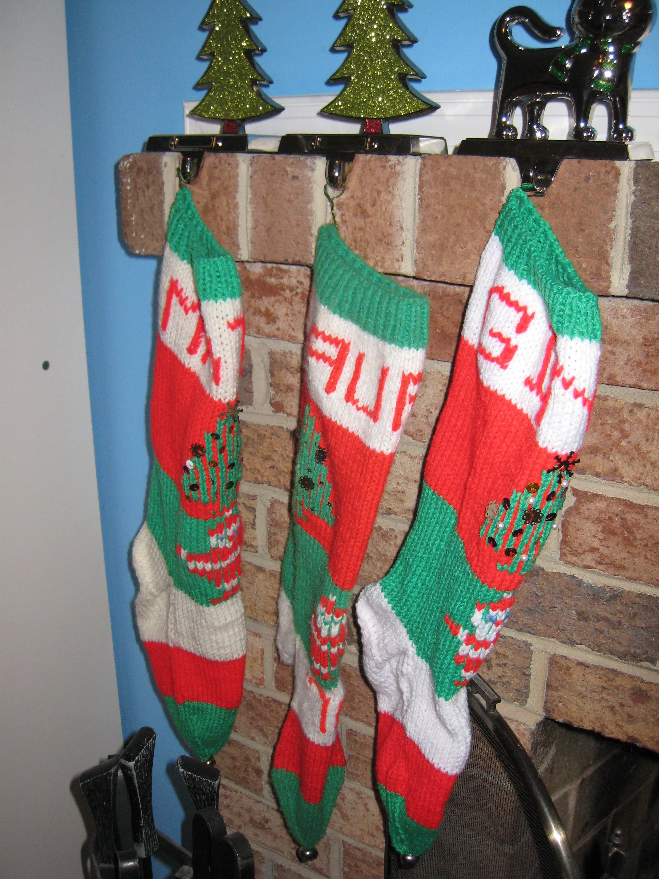 Awesome knit christmas stockings with multicolorful christmas stocking and fireplace at chistmas day interior design
