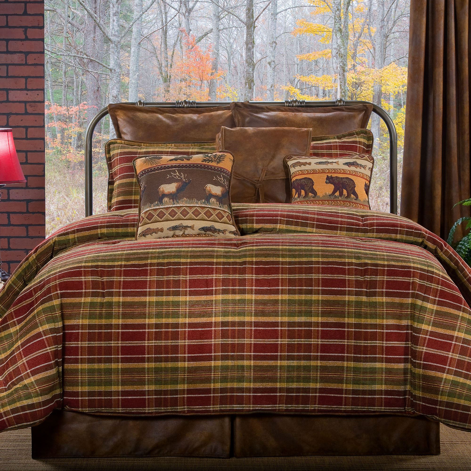 Awesome plaid comforter with rugs and wooden floor plus headboard and sidetable also pillows