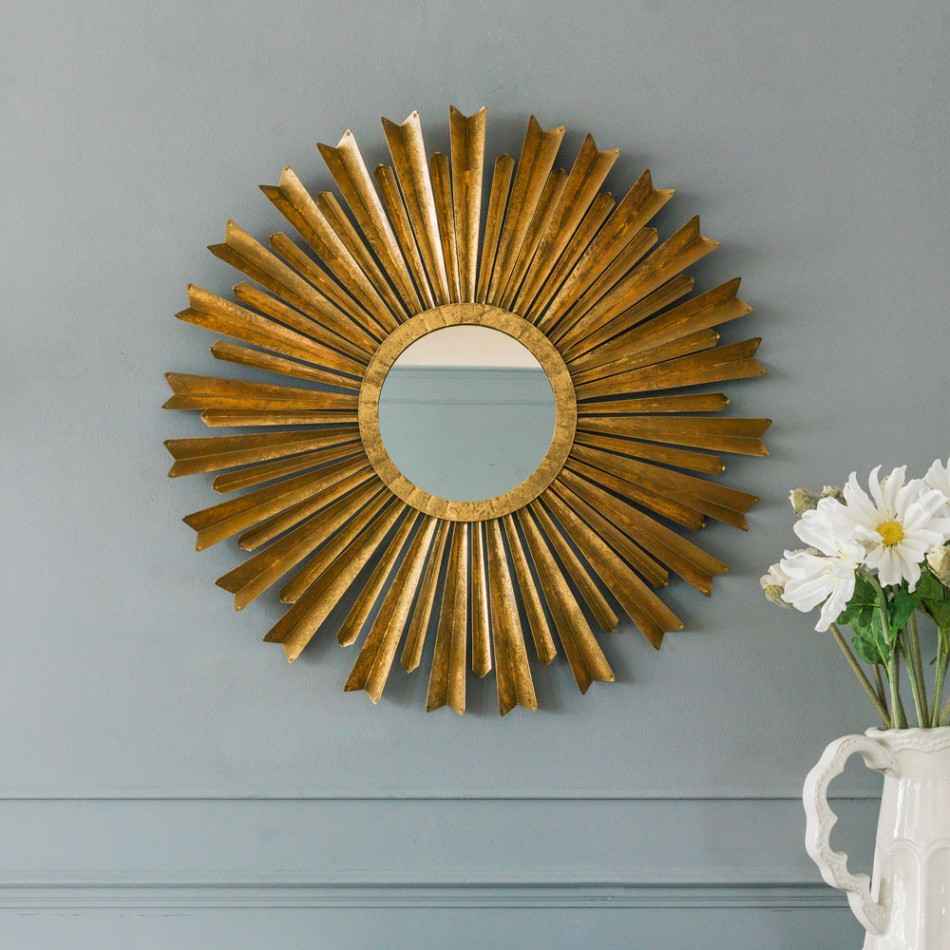 Awesome sunburst mirrors with rustic table and night lap combined plus luxury wall