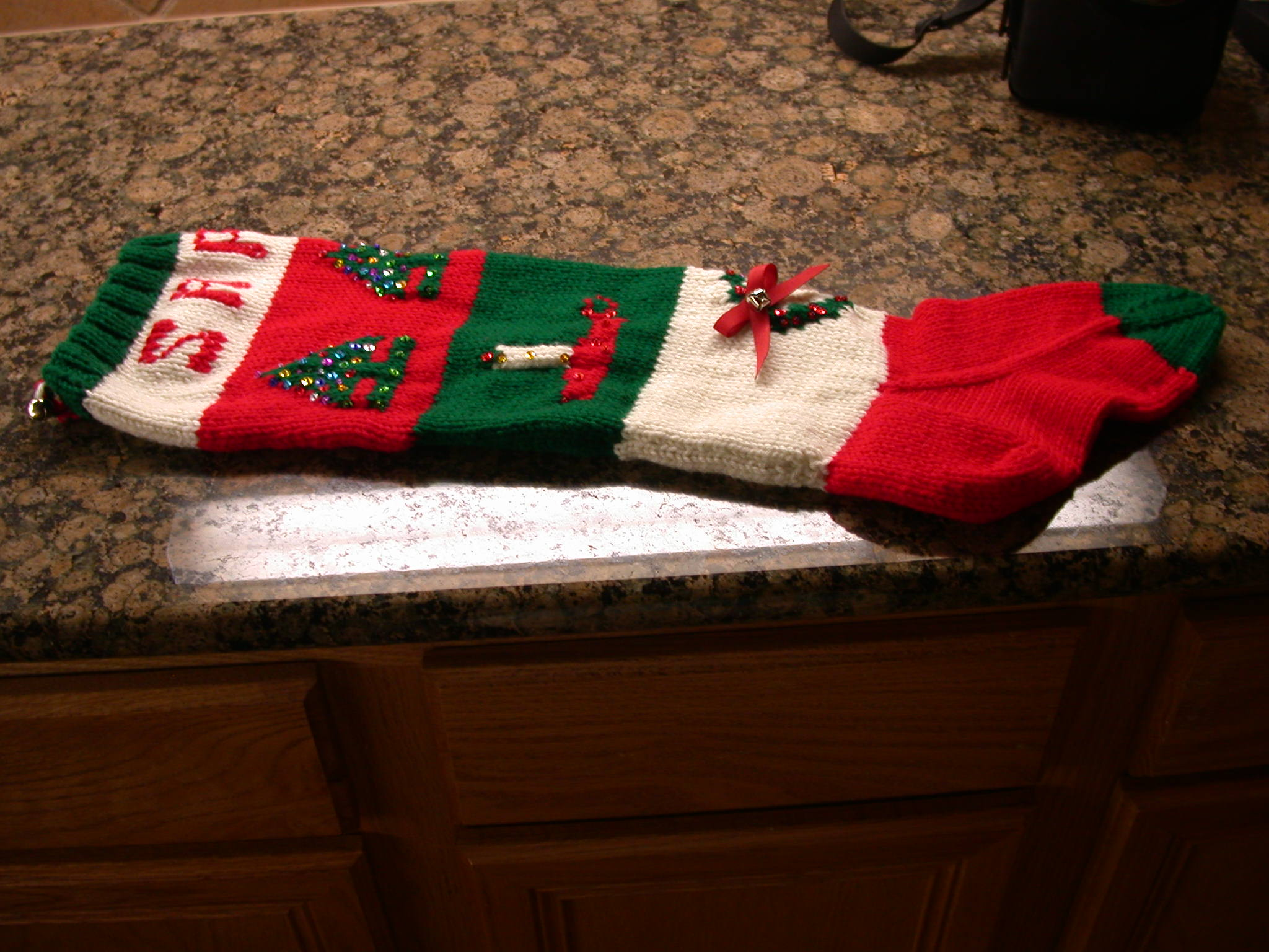 Beautiful knit christmas stockings with multicolorful christmas stocking and fireplace at chistmas day interior design