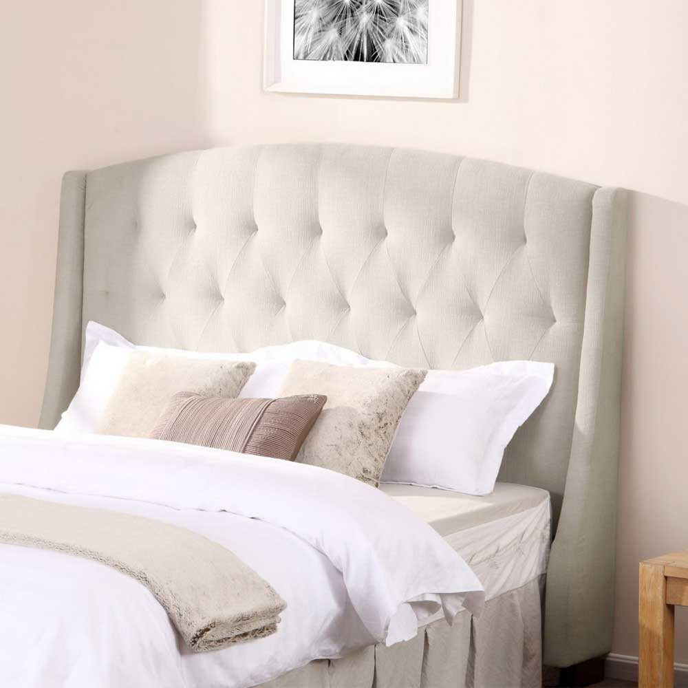 Beautiful quilted headboard with pillows and queen bed size platform decorating combined with night lamp and sidetable