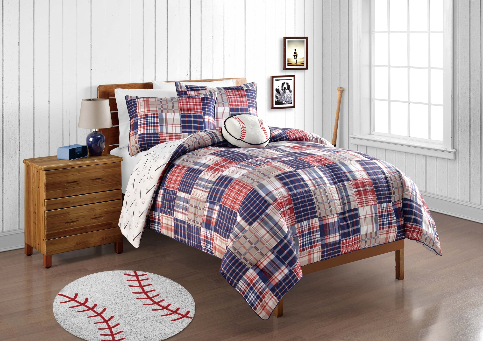 Breathtaking plaid comforter with rugs and wooden floor plus headboard and sidetable also pillows