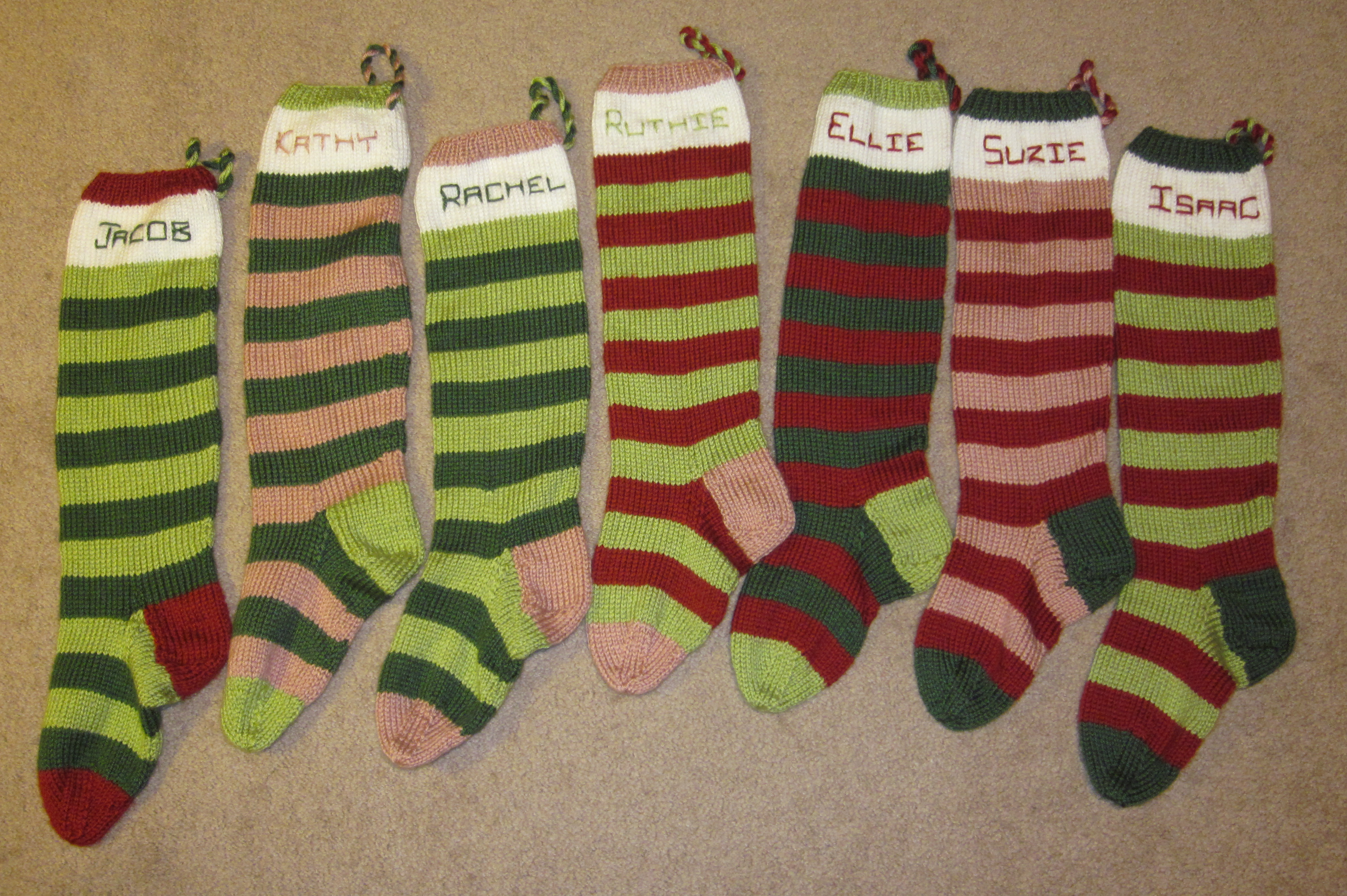 Brilliant knit christmas stockings with multicolorful christmas stocking and fireplace at chistmas day interior design