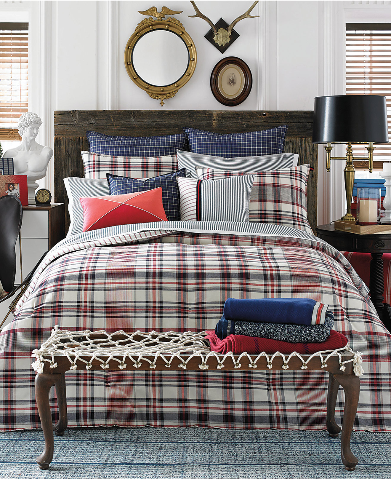 Captivating plaid comforter with rugs and wooden floor plus headboard and sidetable also pillows