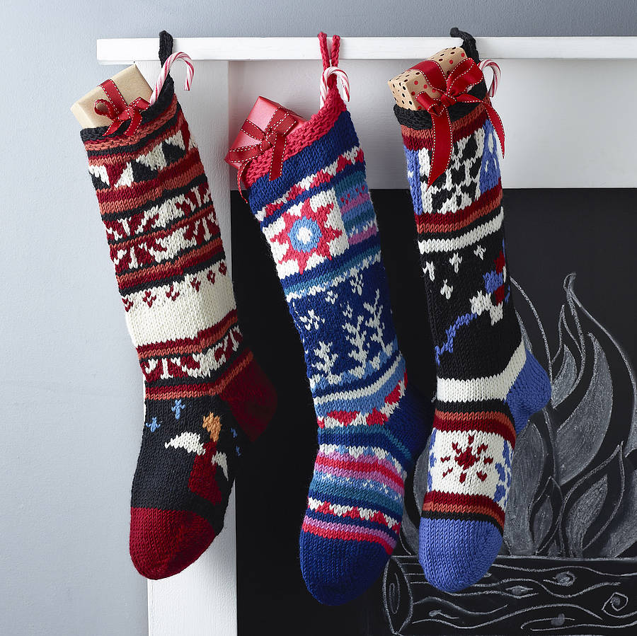 Charming knit christmas stockings with multicolorful christmas stocking and fireplace at chistmas day interior design