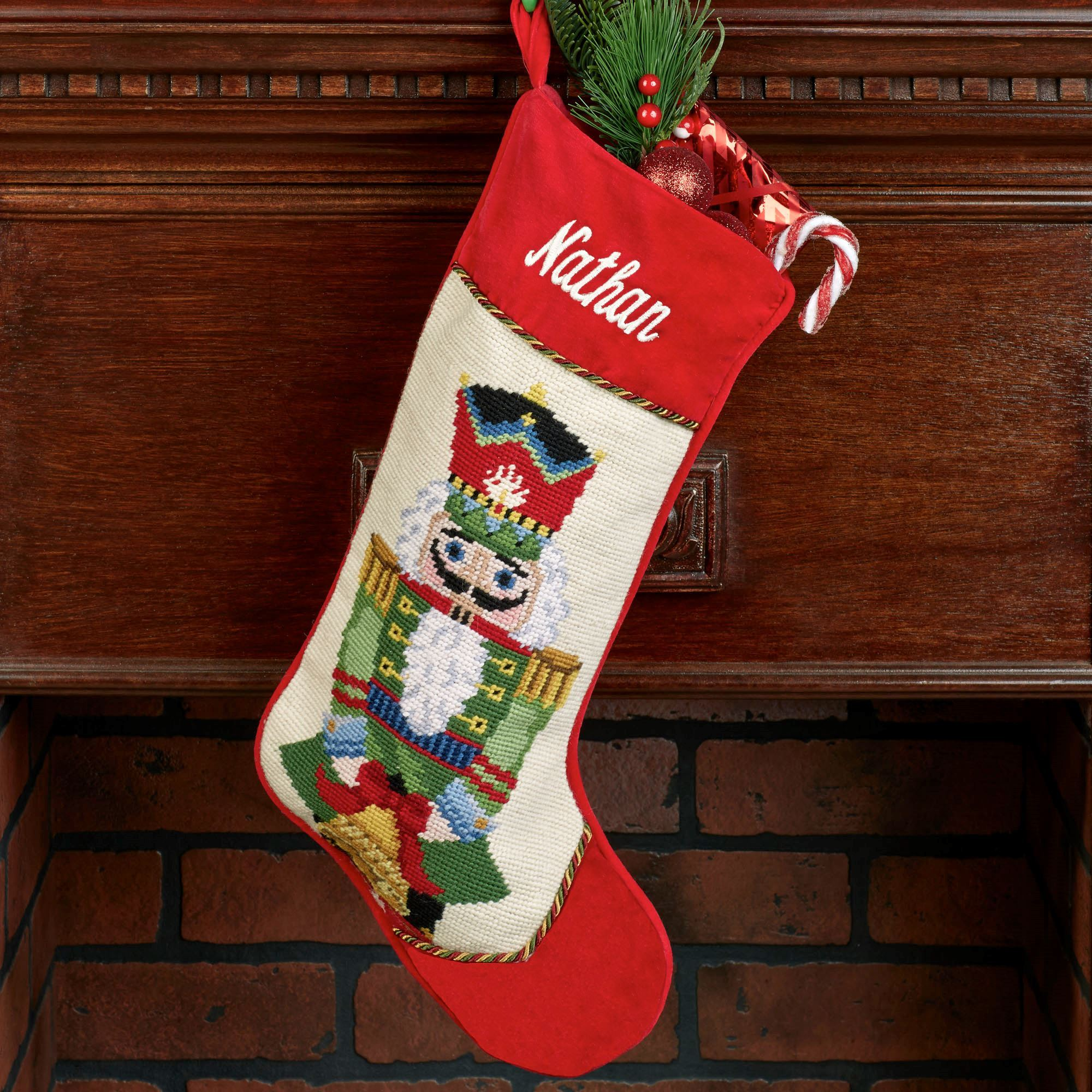 Charming needlepoint stockings and fireplace with mantle shelves in the christmas day