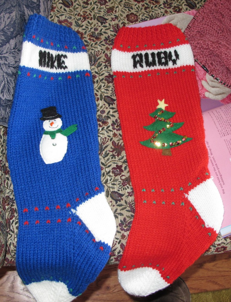 Chic Knit Christmas Stockings With Multicolorful Christmas Stocking And Fireplace At Chistmas Day Interior Design