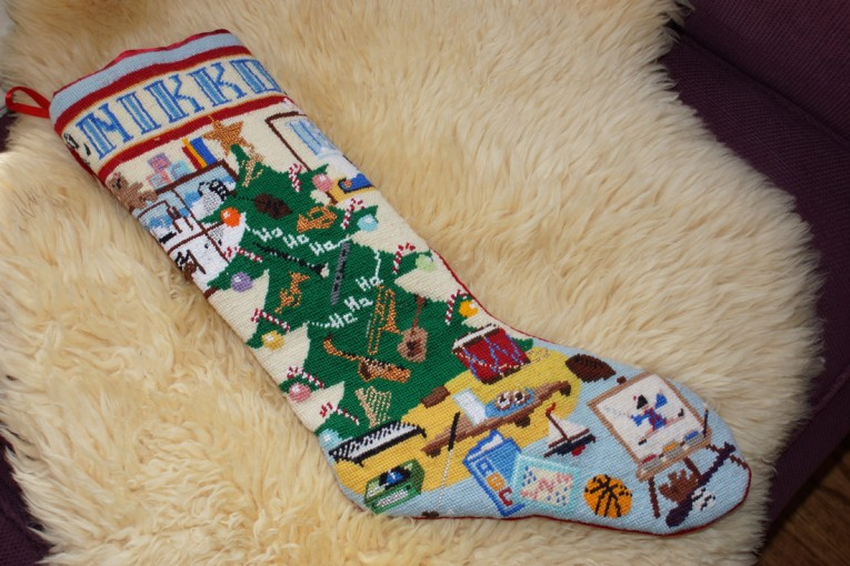 Chic Needlepoint Stockings And Fireplace With Mantle Shelves In The Christmas Day