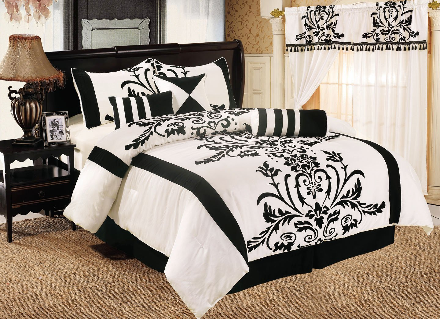 Classy Bedroom with black and white comforter sets and laminate porcelain floor also curtain and sidetables