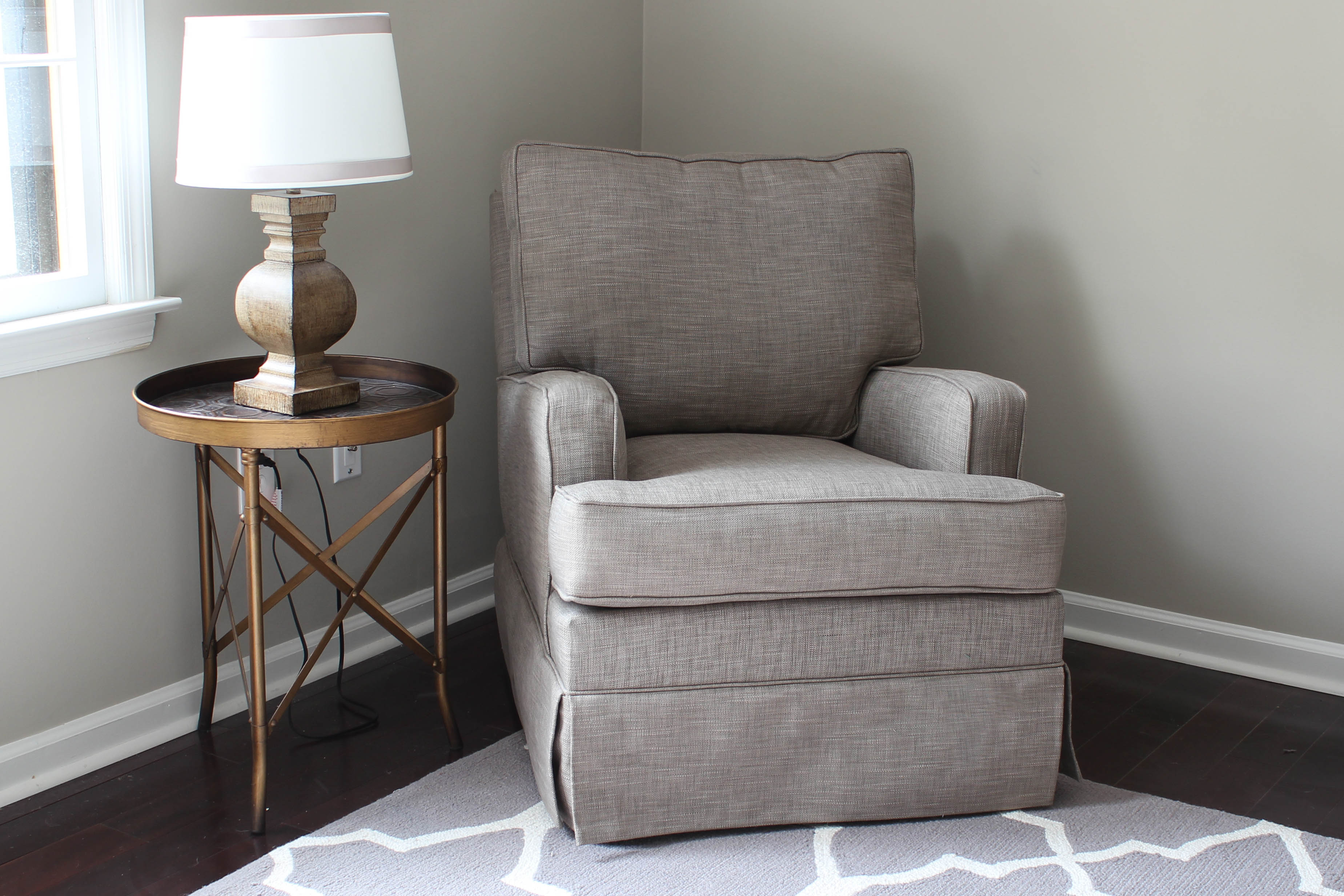 Classy fabric upholstered glider rocker with armchairs and wooden laminate floor for living room