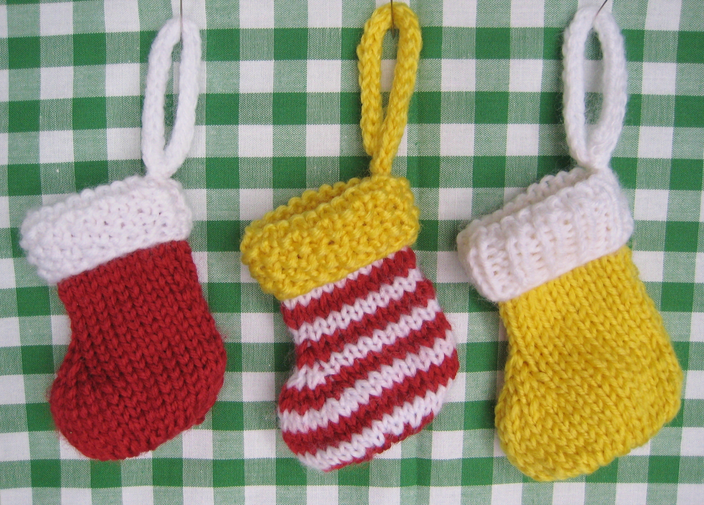Classy knit christmas stockings with multicolorful christmas stocking and fireplace at chistmas day interior design