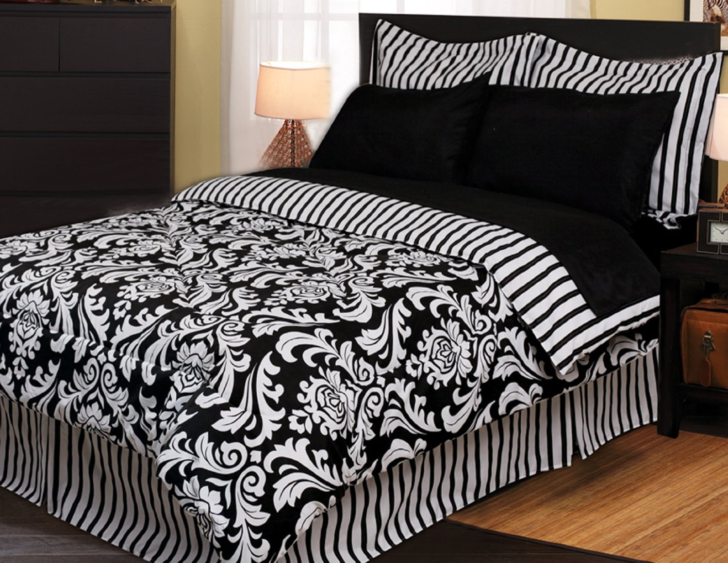 Comfy Bedroom with black and white comforter sets and laminate porcelain floor also curtain and sidetables