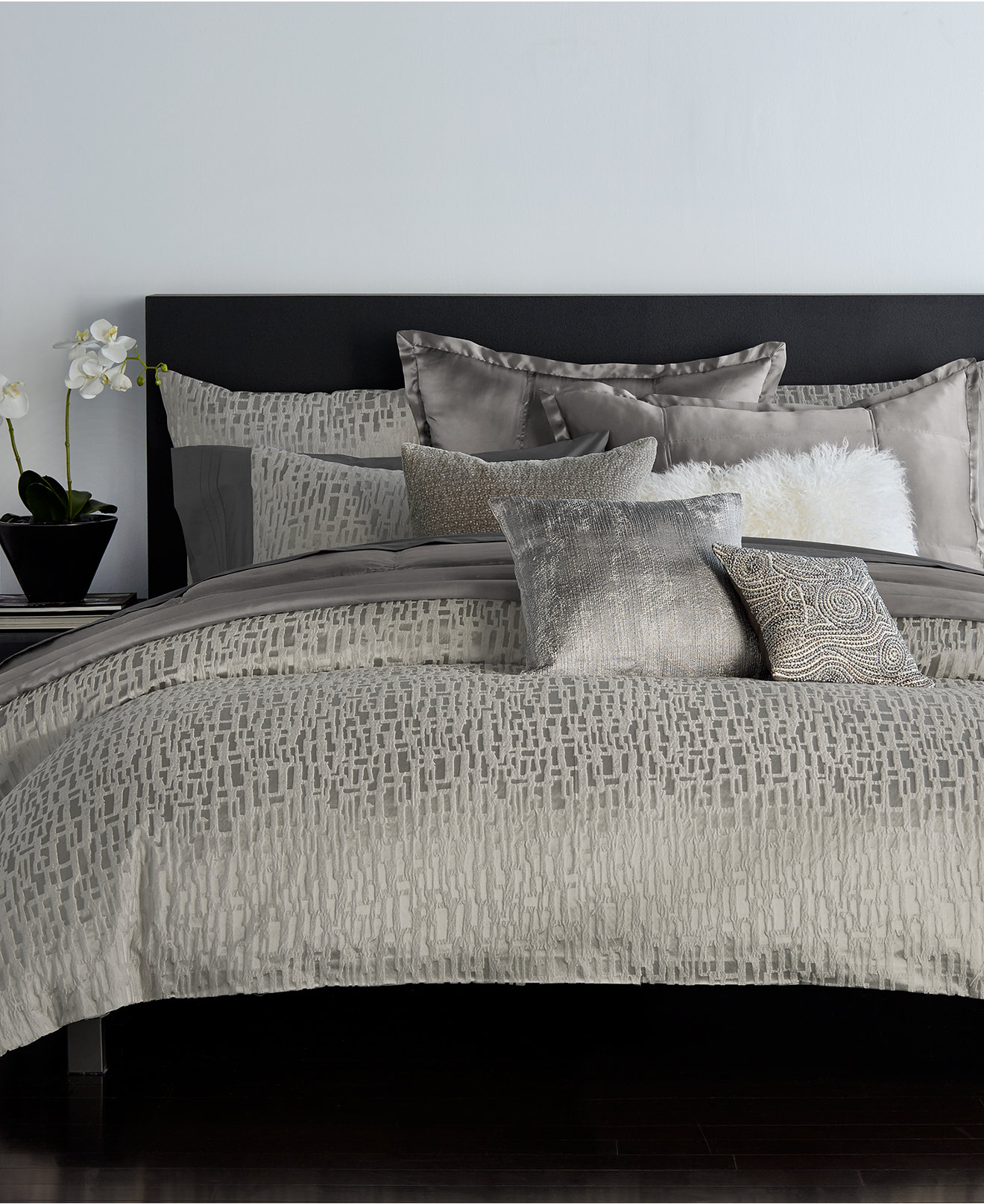 Comfy donna karan bedding with Cushion and pillows also beautiful duvet cover and sidetable and luxury wall paint color