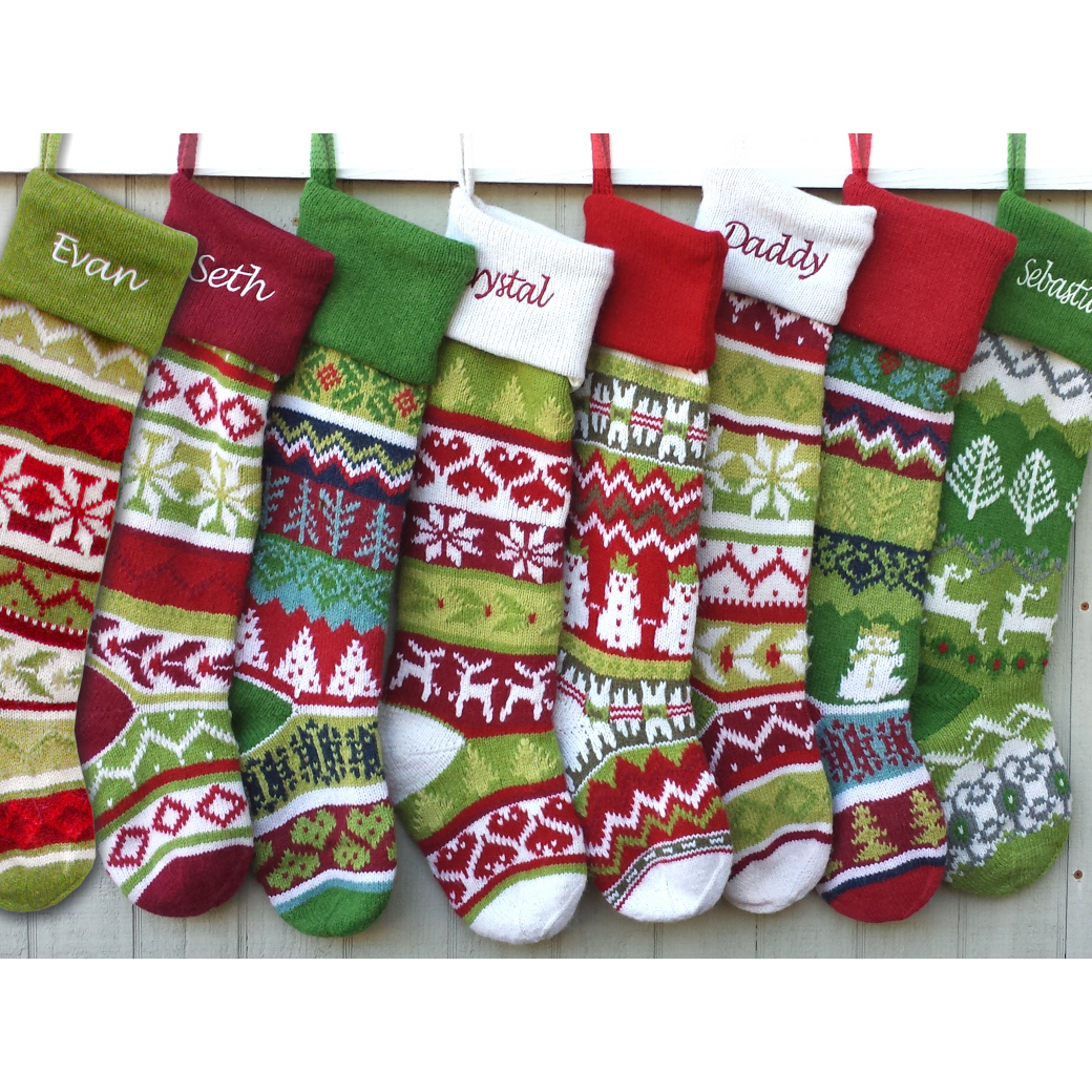 Cool knit christmas stockings with multicolorful christmas stocking and fireplace at chistmas day interior design
