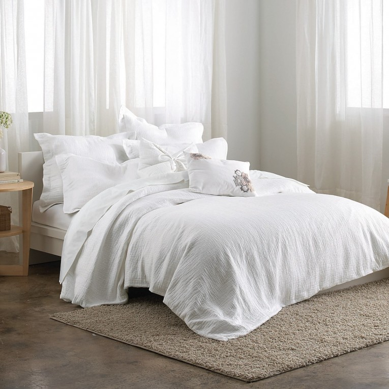 Cozy Donna Karan Bedding With Cushion And Pillows Also Beautiful Duvet Cover And Sidetable And Luxury Wall Paint Color