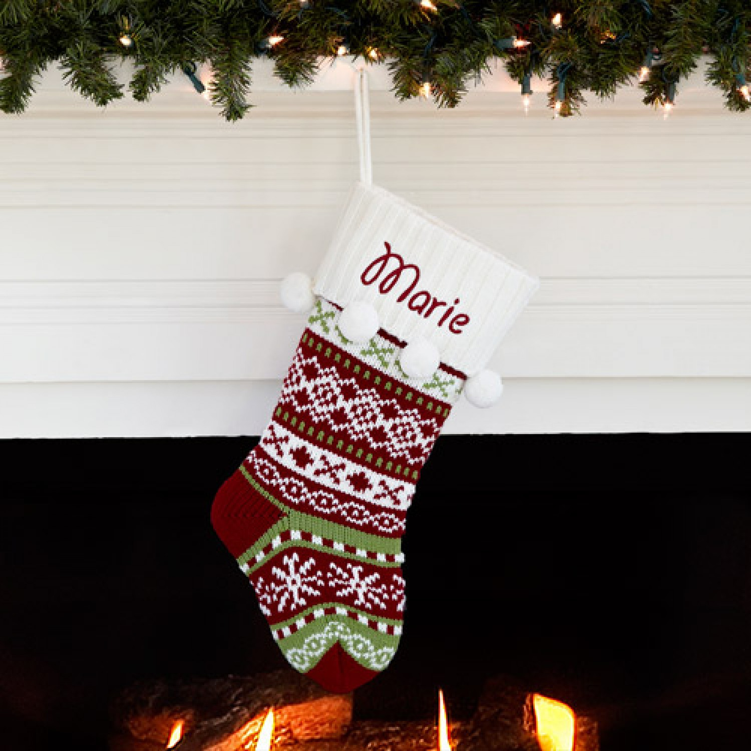 Cozy knit christmas stockings with multicolorful christmas stocking and fireplace at chistmas day interior design