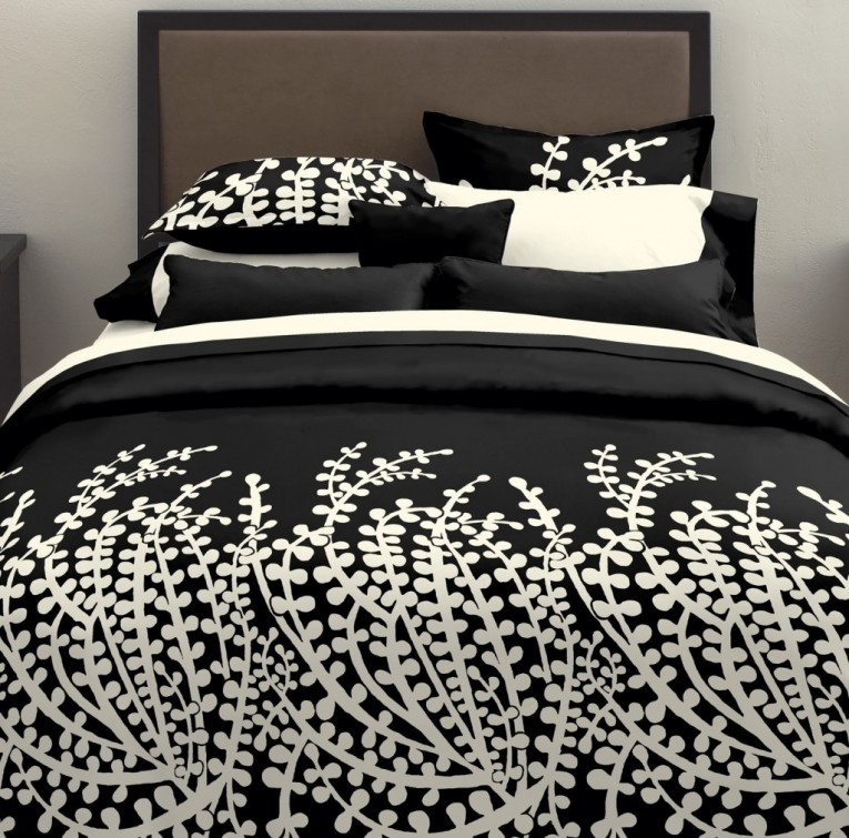 Cute Bedroom With Black And White Comforter Sets And Laminate Porcelain Floor Also Curtain And Sidetables