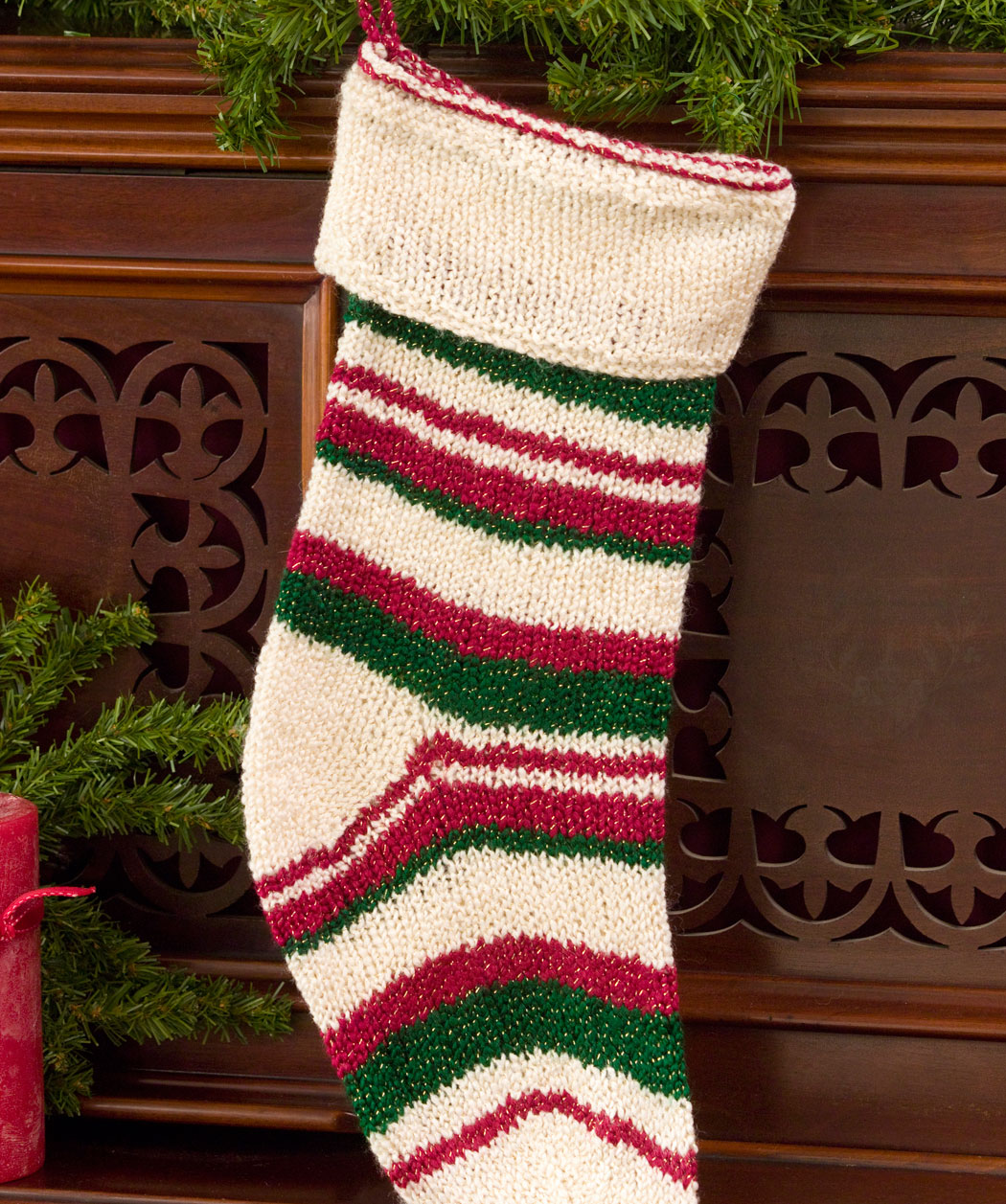 Cute knit christmas stockings with multicolorful christmas stocking and fireplace at chistmas day interior design