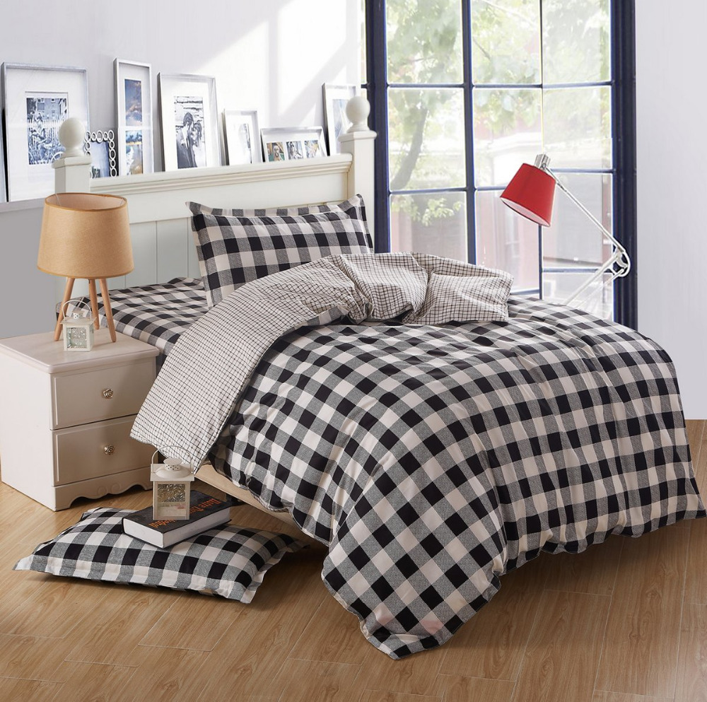 Dazzling plaid comforter with rugs and wooden floor plus headboard and sidetable also pillows