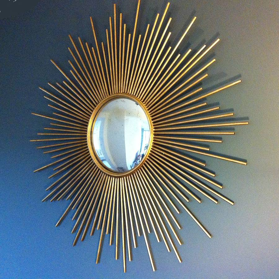 Dazzling sunburst mirrors with rustic table and night lap combined plus luxury wall