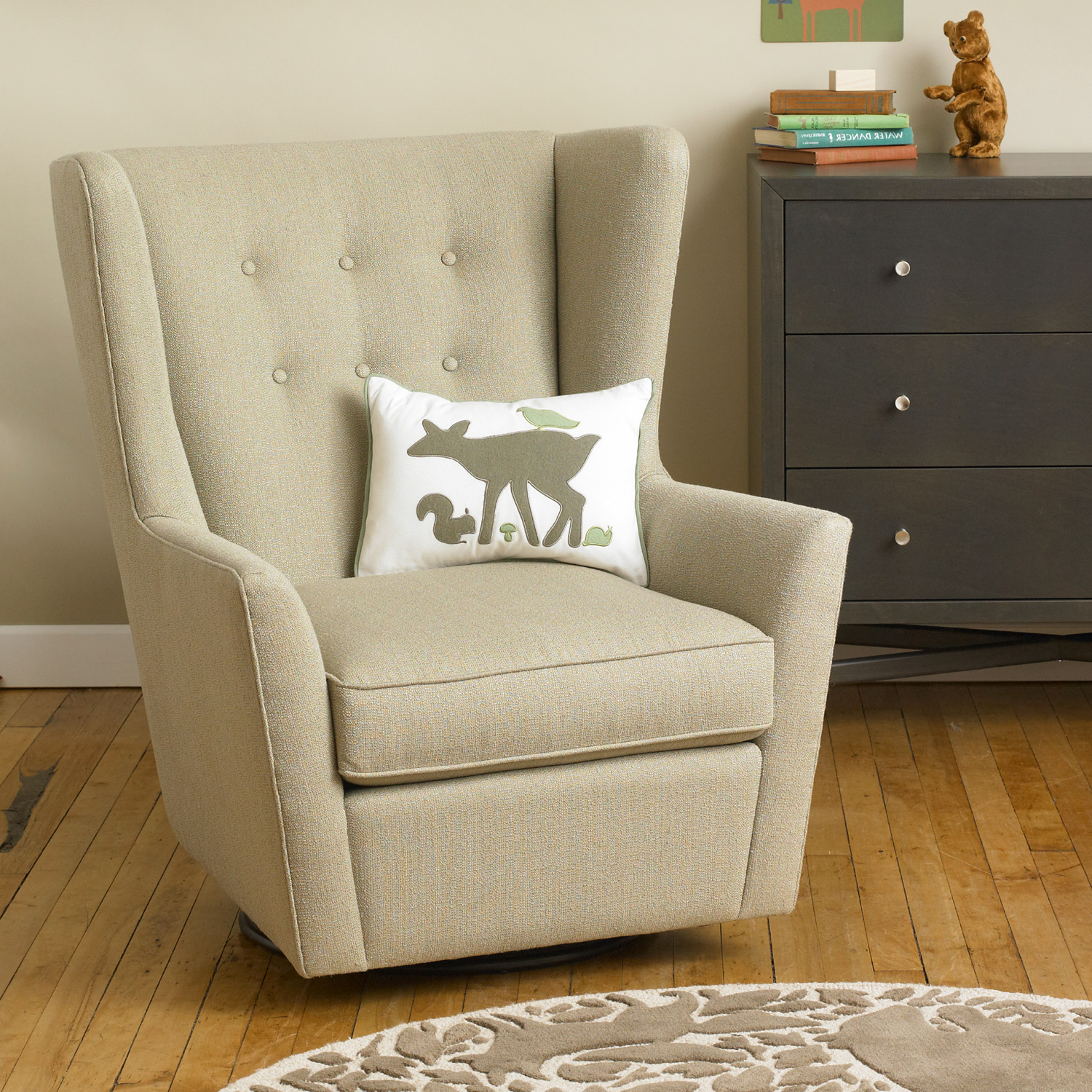 Elegant fabric upholstered glider rocker with armchairs and wooden laminate floor for living room
